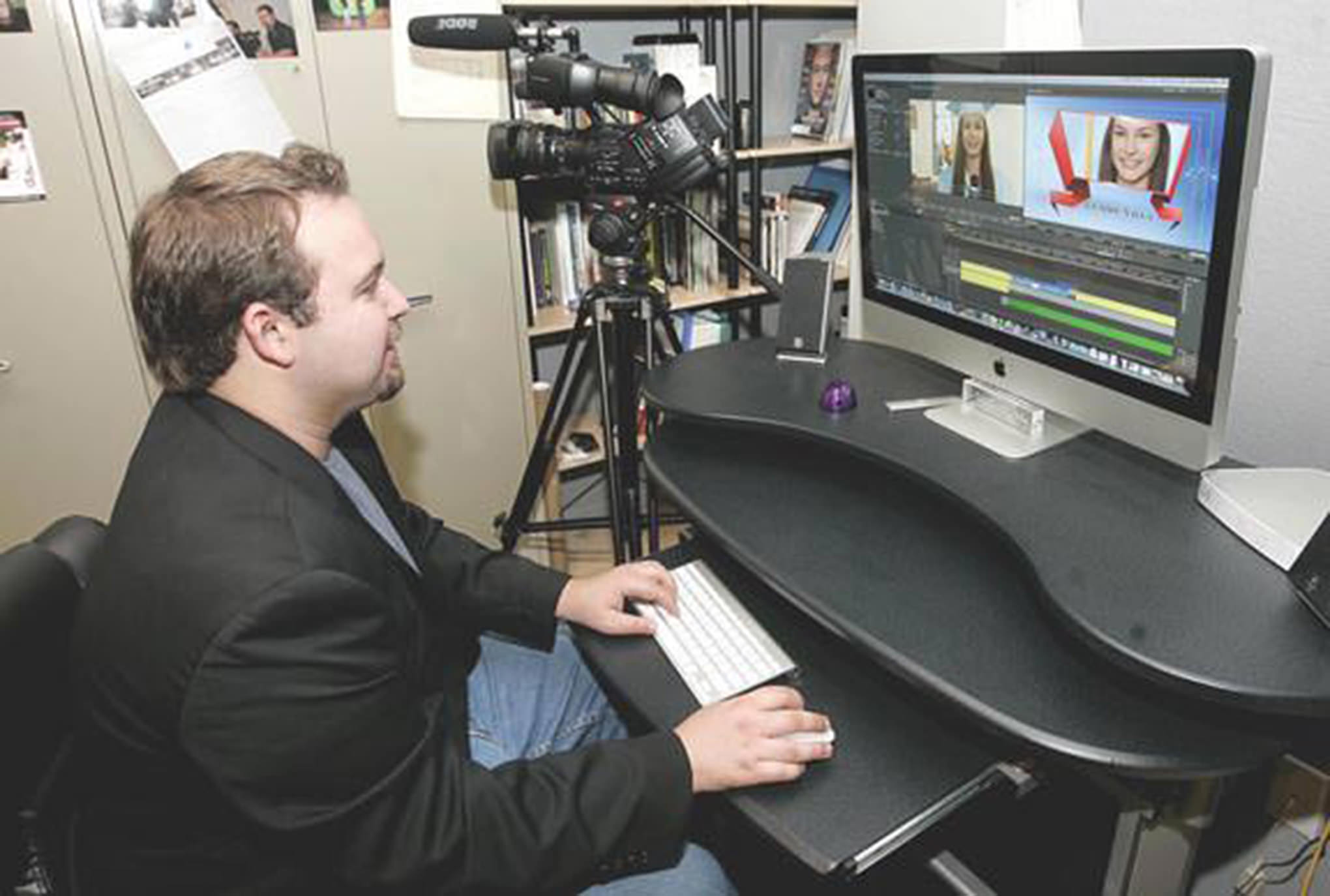 Joshua Cordero shows off his studio and video production business inside his home in Armona on Wednesday afternoon. (Gary Feinstein/The Sentinel)
